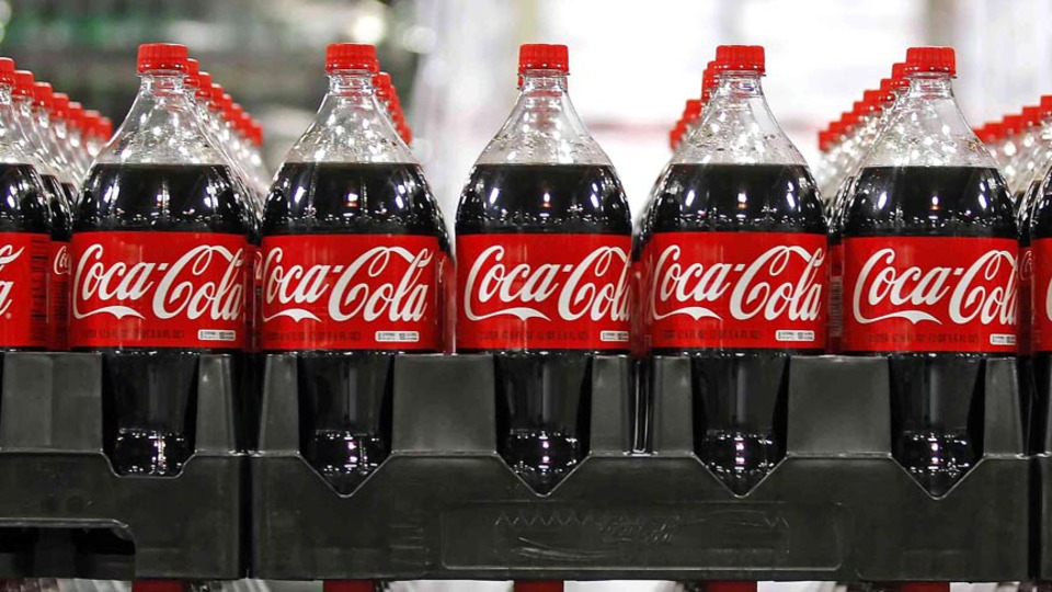 File photo of bottles of Coca-Cola seen in a warehouse at the Swire Coca-Cola facility in Draper